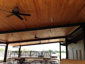 Covered deck with wood ceiling outside the tasting room.