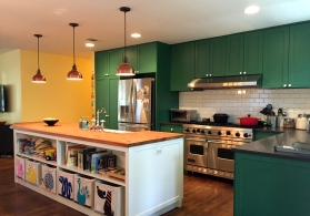 In addition to housing the sink, the large kitchen island adds a lot of extra storage and counter space. The island is made from reclaimed wood from an old barn.