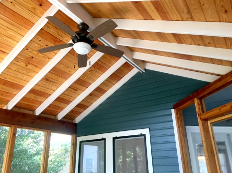 In order to build this screened-in porch, we had to do some foundation work and create an addition to the back of the house. We used cedar for this warm, natural look and a vaulted ceiling so the space feels bigger.